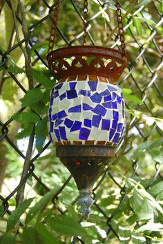 I hang random things in my garden - a Turkish glass lamp.