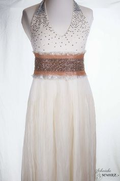 https://www.cityblis.com/7808/item/12091  Vintage Starlight Wedding - $849 by Schnieke & Schmitz  Beautiful unique neckholder wedding dress with lots of sequins and little glass perls at the upper part,and crashed base. Inclusive seperate variable ebroidered silk belt( with lots of rocailles beads).