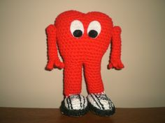 This is Gossamer, the monster from Looney Tunes. He stands at about 7 inches tall and is made of 100% acrylic yarn, cotton yarn on the shoes, which I also used acrylic paint on. I used felt for the eyes. #crochet #amigurumi #gossamer