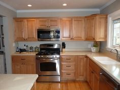 example of honey maple cabinets with Benjamin Moore Revere Pewter paint