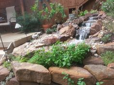 Waterfall created by Texas Ponds and Water Features. #WaterfallWednesday
