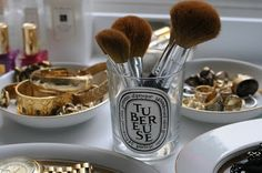 Great idea - I never thought about reusing my Dyptique candle glasses as a brush holder!!