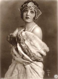 Madge Bellamy, 1920s German postcard. Looks like she's wearing a Kokoshnik inspired headdress.