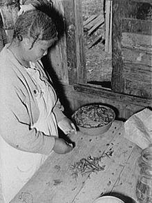 Preparing poke salad, near Marshall, TX, c. 1930.