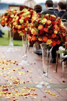 Fall Wedding - Aisle to Table. Love the colors and tall vases! http://www.bridesign.com/wedding-flower-deals