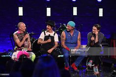 Musicians Flea, Anthony Kiedis, Chad Smith and Josh Klinghoffer of Red Hot Chili Peppers speak onstage during their album release party on AT