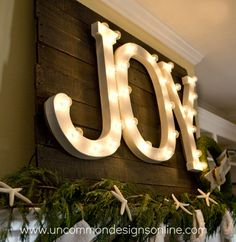 DIY TUTORIAL HOW TO MAKE THE WORD JOY WITH LIGHTS. This is part of a Christmas Mantle A Pallet with Joy in lights, a moss and Burlap wreath and Burlap Stockings......Just so darn cute...Thanks for Sharing