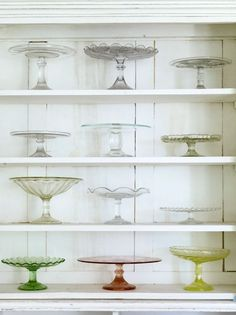 Pretty cake stands; great display idea - and links to a lovely seaside vintage home article with more images