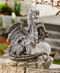 Medieval Times Dragon with Gazing Ball Statue. Majestic silver dragon sits on a gray pedestal with a glass gazing ball. Dragon King, Dragon Statue, Fantasy Creatures, Mythical Creatures, Dragon Garden, Dragon's Lair, Dragon Figurines, Dragon Artwork, Dragon Jewelry