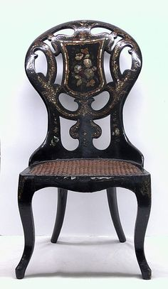 Chair, Side (one of a pair)  Date: mid-19th century Culture: English Medium: Black lacquered, painted and gilded wood and papier mâché, mother-of-pearl, red velvet cushions