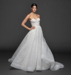 Style 3957 Marigold Lazaro bridal gown - Ivory floral embroidered tulle ball gown, strapless sweetheart neckline, corset bodice accented with petal applique, natural waist, circular skirt with chapel train. Lazaro Dresses, Lazaro Wedding Dress, Lazaro Bridal, Dream Wedding Dresses, Bridal Gowns, Wedding Gowns, Making A Wedding Dress, Classic Wedding Dress, Tulle Ball Gown