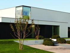 Nieuwbouw • modern • strak • plat dak • hoekraam • gevelpleister • Foto: www.dumobil.be