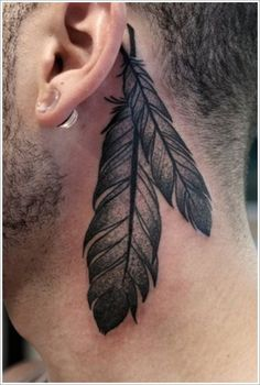 Awesome feather tattoo behind a mans ear | Tattoomagz.com