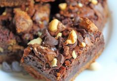 Peanut Butter Cup Cookie Brownie Bars has a cookie bottom with a layer of peanut butter cups topped with a brownie mix, chocolate chips and peanuts.  Over the top?  Oh Yeah!