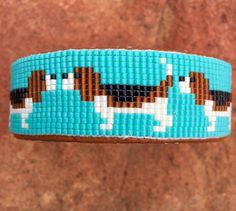 Items similar to Beaded Beagle Bracelet on a turquoise background. This bracelet is a beagle lovers joy. Handmade by the Artist. on Etsy Loom Bracelet Patterns, Bead Loom Bracelets, Bead Loom Patterns, Bracelet Designs, Silver Bracelets, Beading Patterns, Turquoise Background, Beaded Animals, Seed Bead Earrings