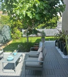Lay down a quick-fix outdoor patio with RUNNEN floor decking and treat yourself to an alfresco lounge | Christelle's garden, France