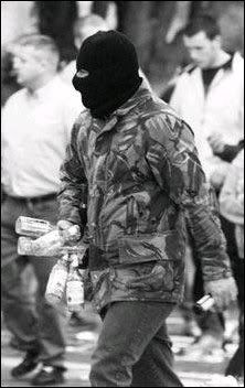 Masked Irish Republican Army volunteer carrying glass bottles that are used to craft petrol bombs. Summer Activities For Kids, Summer Kids, Northern Ireland Troubles, Time In Ireland, Irish Republican Army, Michael Collins, Fighting Irish, Guerrilla, Belfast