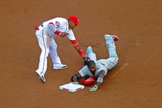 Safe at second for a double -  Ryan Howard of the Philadelphia Phillies beats the tag by Yunel Escobar of the Washington Nationals at second base for a double in the second inning during a baseball game at Nationals Park on May 22 in Washington. - © Mitchell Layton/Getty Images