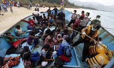 Sri Lankan migrants refuse to leave Indonesian waters and demand fuel to continue their journey to Australia after becoming stranded at Lhoknga Beach, Aceh, Indonesia, in June 2016