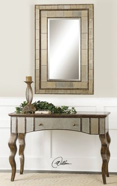 Uttermost mirror that goes with Almont console table but Almont is 18 inches depth