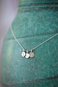THREE Charms Tiny Initial Necklace in Sterling Silver by annekiel.  Want this after Baby #3 is born!