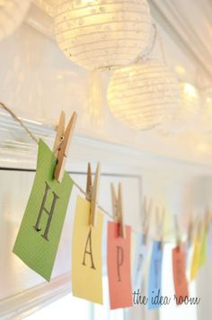 simple happy birthday banner made with card stock and letter stickers - pair with a string of paper lantern lights