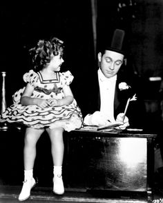Shirley Temple and James Dunn on the set of Stand Up and Cheer, 1934