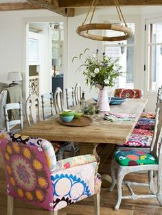 Love everything except the fabric on chairs. But I want a farmhouse table with mismatched chairs big enough for entire family!