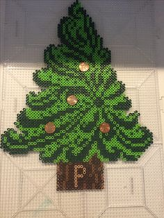 Perler Christmas tree with pennies with birth year facing up as ornaments gift