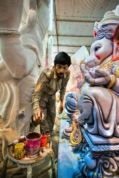 Artisan prepares Hindu God Ganesh, Bangalore, India