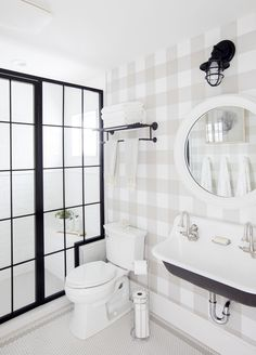 Jillian Harris Spare Bathroom buffalo plaid walls white round mirror vintage sink shower