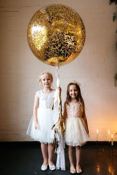 flower girls - photo by Katie Harmsworth Photography http://ruffledblog.com/mixed-metals-wedding-inspiration