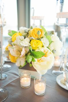 Bright and cheery centerpieces   Whimsical NYC Wedding at Battery Gardens from Twah Dougherty  Read more - http://www.stylemepretty.com/new-york-weddings/2013/09/23/whimsical-nyc-wedding-at-battery-gardens-from-twah-dougherty/