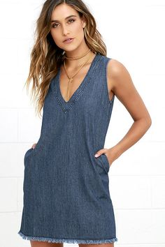 Your denim dress dreams are now a reality thanks to the Chic All Day Blue Chambray Shift Dress! Cute and classic shift dress has a sleeveless bodice, deep V neckline, and side seam pockets all in a lightweight chambray. Back-stitched, frayed bottom hem. Back keyhole with top button.