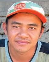 His name is Madi. His living in harmony because he have a good job and a good live in Surabaya. By   Jason F.  6A
