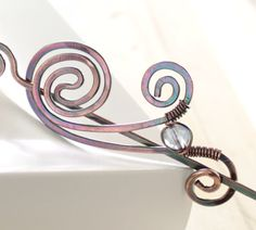 Shawl pin or scarf pin in snail shape with light by IngoDesign, $26.00