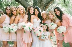 Bridesmaids in mix matched chiffon & lace dresses with blush flowers and green vines for bouquets // Vis Photography