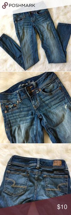 AE Double Button Distressed Skinny Jeans Never worn, stretchy fit, skinny, size 0. American Eagle Outfitters Jeans Skinny