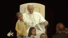 He refused to leave the pope's side, even at the encouragement of several cardinals. | Boy Wanders Onto Stage To Hang Out With Pope Francis