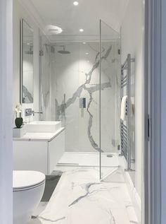 En suite bathroom with large format polished statuario marble porcelain. En suite bathroom with large format polished statuario marble porcelain. Bathroom Design Luxury, Bathroom Layout, Modern Bathroom Design, Luxury Bathrooms, Modern White Bathroom, Master Bathrooms, Marble Tile Bathroom, White Marble Bathrooms, Marble Tiles