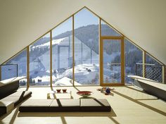 """Perched high up in the Swiss Alps, this mountain cabin design by architecture firm Drexler Guinand Jauslin is the essence of the """"mountain chalet. Attic Design, Loft Design, Modern House Design, Modern Houses, Beton Design, Concrete Design, Attic Renovation, Attic Remodel, Chalet Chic"""