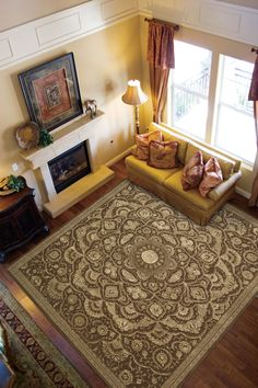 Soft, velvety chocolate tones unfold from a center medallion with a mesmerizing, mandala-like effect. Paler tones of toffee and vanilla display the pure silken highlights of this gorgeously woven and hand-carved rug to full effect. Classic in its origins, modern in its tonal harmony, it brings a special beauty to the home. #traditional #neutral Tonal Harmony, Living Spaces, Living Room, Classic Rugs, Traditional Rugs, Hand Carved, Area Rugs, Carving, Pure Products