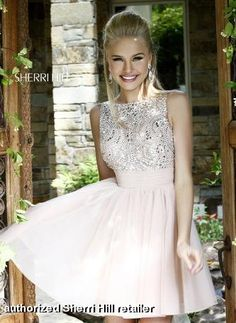 Prom Dress by Sherri Hill style 11032. Cute, short prom dress with vintage beading. Comes in multiple colors!