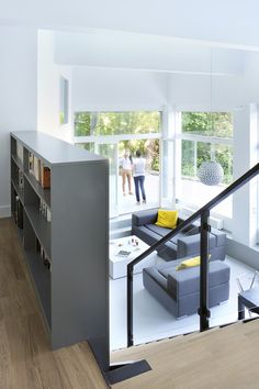 Note bookcase material extends down the steps (grey color)  Garden flat in Lyon photographed before and after a party