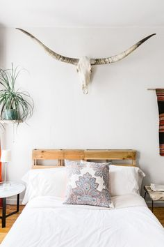 The longhorn skull from New Mexico is definitely my sprit animal (I am a Taurus after all…). The bedding is from Parachute Home and Matteo Home, both out of Los Angeles, and the custom pillow is from Loom Decor.