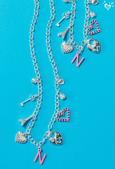 Charmed, I'm sure. Customize this silver chain with charms that mean something sweet to her!