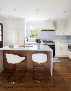 a chic modern kitchen in white with brass accents and a bold backsplash | via coco kelley