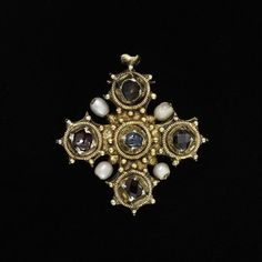 http://collections.vam.ac.uk/item/O13450/pendant-reliquary-cross-unknown/