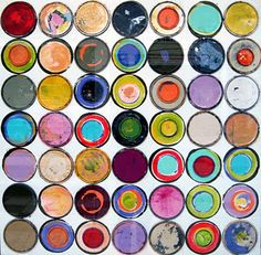 Paint can lid artwork (in an Anthropologie store window)    This is neat!