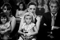 Three bored adults, one amused child and one supermodel in church -  Edward Olive fotografo de boda Valle de los Caidos (cerca de Madrid El Escorial)